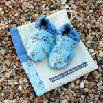 Baby booties, blue flowers,..