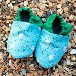 Baby booties, blue and whit..