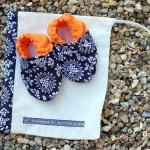 Baby booties, navy and whit..