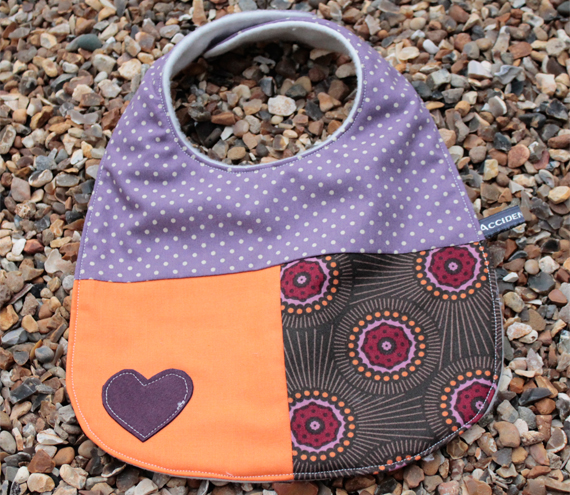 Baby bib - purple, orange bursts